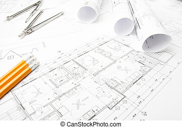 Construction planning drawings on the table and two yellow...