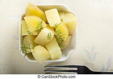Boiled potatoes - Fresh boiled potatoes with dill and fork