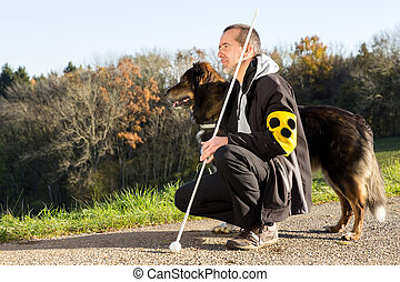 Walk with his guide dog - A blind man on a walk with his...