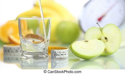 Apple juice poured glass, diet food - Apple juice poured in...
