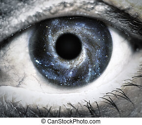 Human eye looking in Universe Elements of this image...