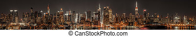 Lower Manhattan skyline at night panoramic view