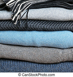 Background with stack of warm woolen clothing - Background...