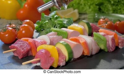 raw meat skewers on stone plate rot - a table spread with...