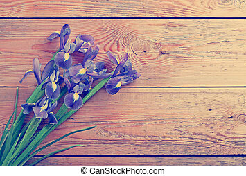 Blue flowers on an old wooden background