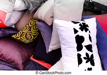 Cushions on a market stall - Assortd cushions for sale on a...