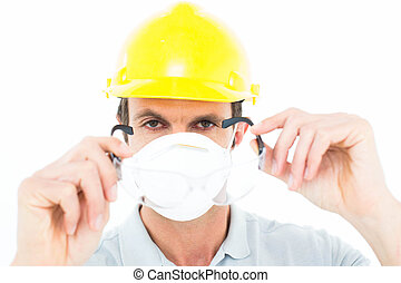 Worker wearing protective glasses over white background -...