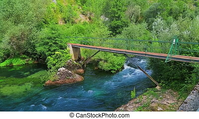 Footbridge on river Krka - Small footbridge on Krka river in...