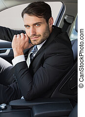 Businessman sitting in drivers seat