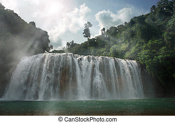 Gloomy jungle waterfall - Panoramic view on a back lit...