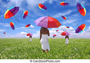 Woman Standing in a Field Holding an Umbrella