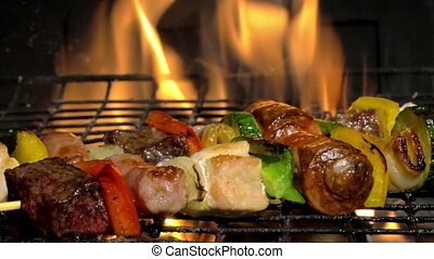grilling meat skewers - broiling meat skewers in a fireplace...
