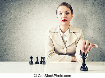 Tactics in business - Serious pretty woman sitting and...