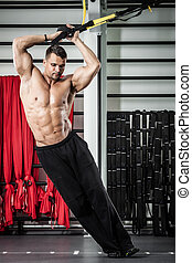 Functional training - Young man streching muscles making...