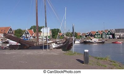 Harbour Isle of Marken pan quay traditional green painted wooden houses
