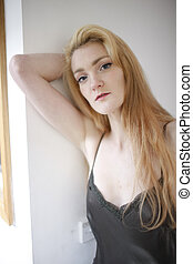 A portrait of a sexy young model with perfect skin and glamour makeup.