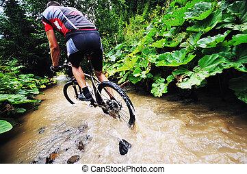 mount bike man outdoor - young man drive mountain bike over...