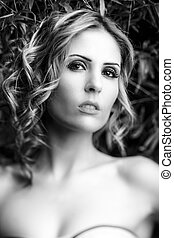 A portrait of a sexy young model with perfect skin and...