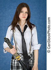 Beautiful girl standing on blue background with japanese sword