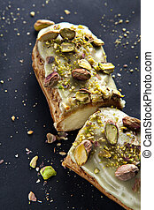 exquisite cream dessert eclair with pistachios with crumbs...