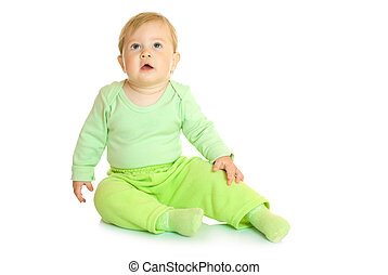 Small sitting baby in green isolated