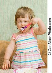 Little funny eating girl