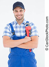 Confident young male repairman holding adjustable spanner -...