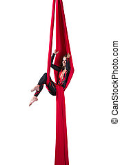Aerial silk dancer - Beautiful young girl performing aerial...