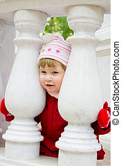 Little smiling gril with marble columns
