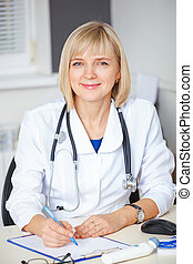 Portrait of confident doctor looking at camera.