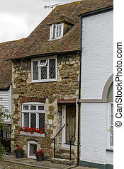 stone cottage, Rye - view of old stone house on a street in...