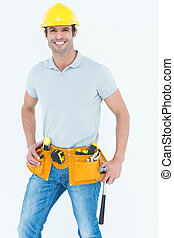 Happy worker holding hammer over white background - Portrait...