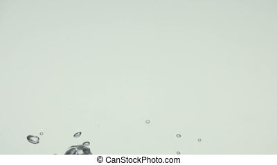 Water bubbles and action over white background - An abstract...