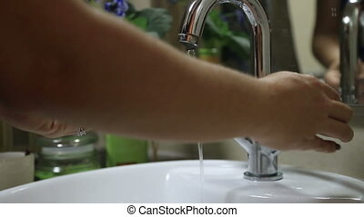 Woman washing her hands - Woman washing her face with soap...
