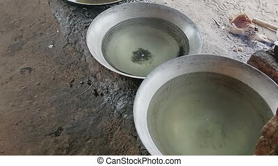 Preparing palm brandy - Myanmar - Production of palm brandy...