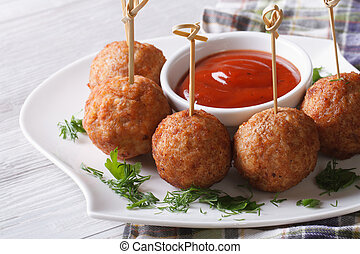 meatballs on skewers and ketchup on a plate, horizontal -...