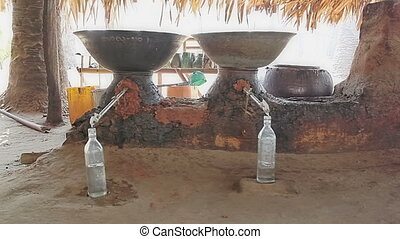 Production of palm brandy and filtering to the bottle in a...