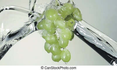 Bunch of green grapes in a spray of water - Dynamic image of...