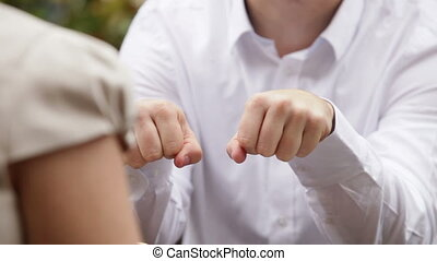 woman and man engagement - man open fists and show the ring...