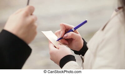 girl write by pen on piece of paper - girl write by pen on...