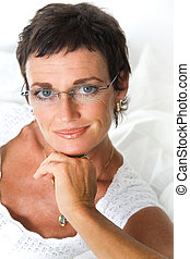 Beautiful mature woman smiling - Portrait of an attractive...