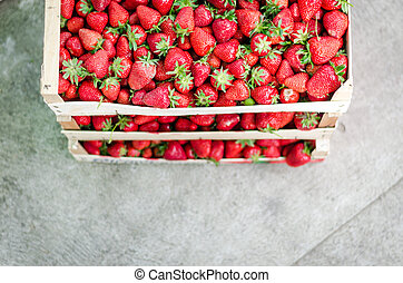 Home grown strawberries in a wooden basket (crate).