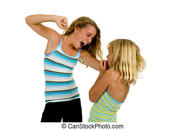 two sister girls having a fight, isolated on white
