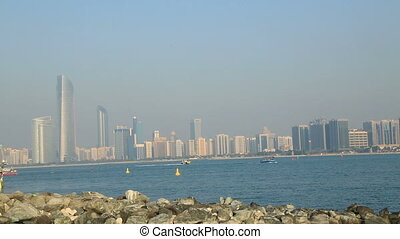 Abu Dhabi view with sailboat - A view of the Abu Dhabi City...