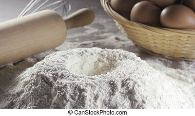 egg in the middle of bleached wheat flour - Close-up of...