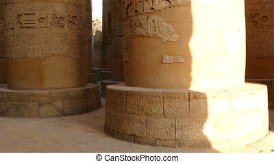 columns in karnak temple with ancient egypt hieroglyphics -...