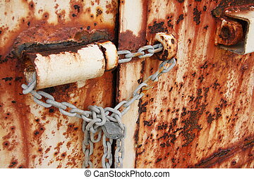 Rusted doors chained and padlocked - Old rusted doors...