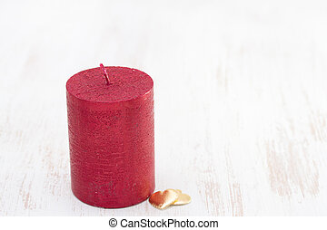red candle with two hearts