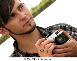 retro camera in photographer\'s hands om the natural...