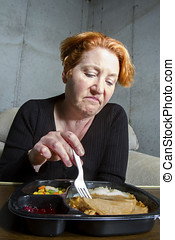 TV Dinner Tonight - Unhappy woman eating a TV dinner
